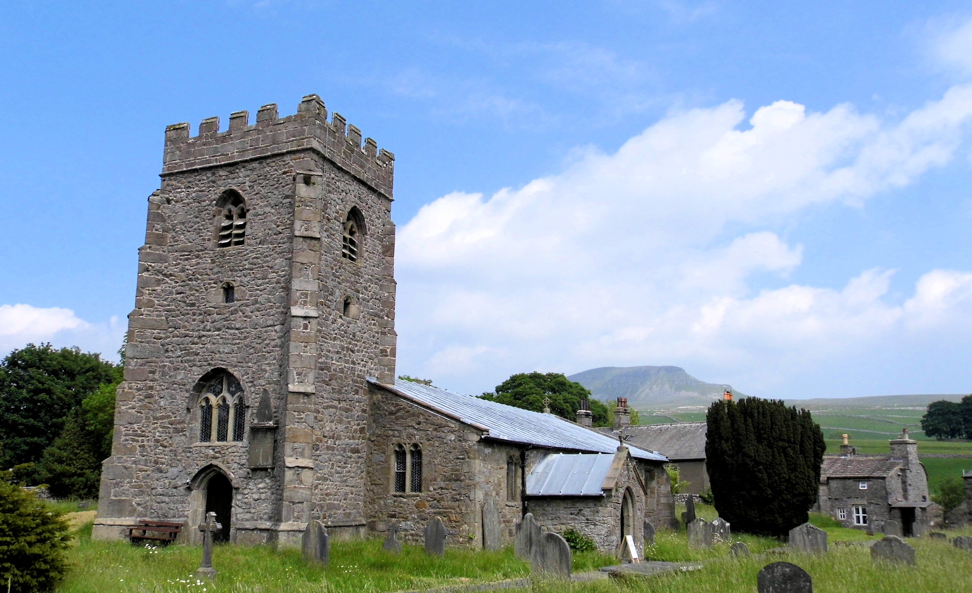 Photo of the view from the churchyard in Horton in Ribblesdale towards Pen-y-Ghent - photo from wikimedia by Steve Kraken
